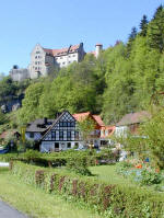 Castle Rabenstein with Neumuehle in Ailsbach valley at Kirchahorn